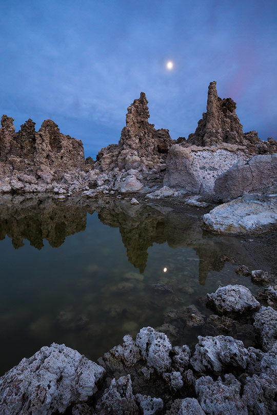 The moon rises over tufa formations at Mono Lake in California.