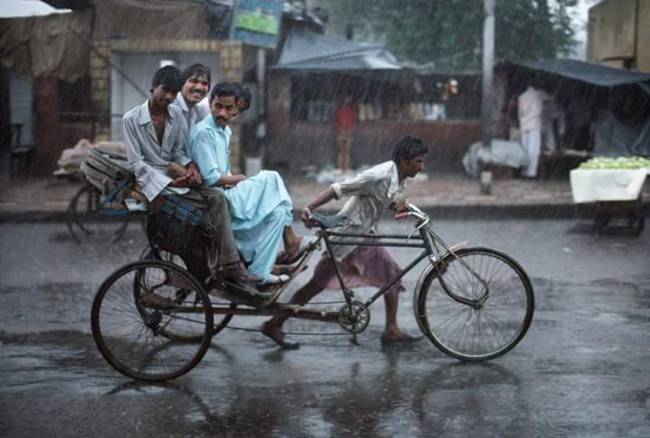 Steve McCurry's rickshaw photo, before the cheerful rider was removed in post.
