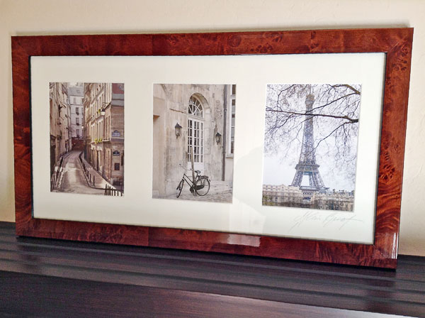 A framed triptych featuring photographs of Paris.
