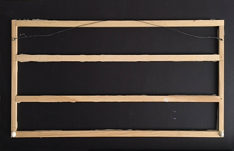 Back side of Tree Triptych, showing black CodaMount Standout with glued-on wood reinforcing strips and rubber bumpers at the bottom.