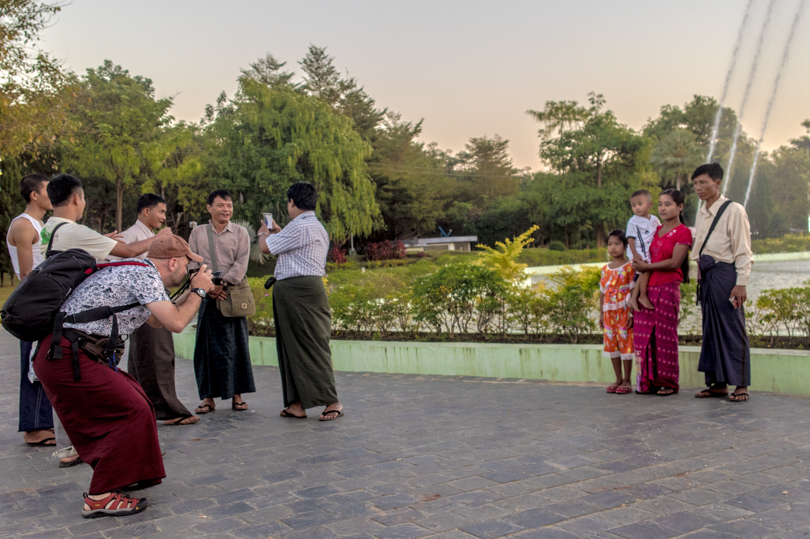 Shot with DXO ONE Camera. Everyone loves their portrait to be taken in Myanmar. This is at the Water Fountain Park at NayPyiTaw. This couple with kids were really amused to find a foreign tourist wearing the traditional Laungyi that they got their portraits taken.