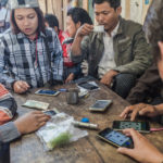 Shot with DXO ONE Camera. A game of Cards, goes Mobile at the Jade Market, Mandalay.