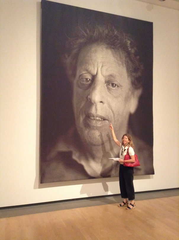 Natalie at the Phoenix Art Museum, looking at a giant photograph of Philip Glass by Chuck Close, part of his 'Family and Others' series.