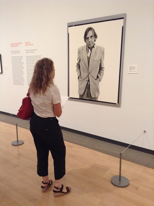 Natalie looking at one of Richard Avedon's photographs from the 'In the American West' series. Phoenix Art Museum