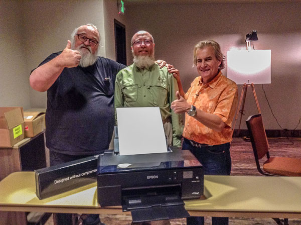 Last year we raffled the Epson Printer we used to print participants work during the Summit. The raffle was won by Mike (between Jeff and Alain) who returned home with a free printer, a set of extra ink cartridges and boxes of Epson inkjet paper.